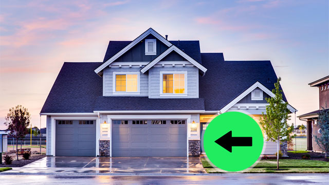 arrow pointing to the bottom floor of modern house